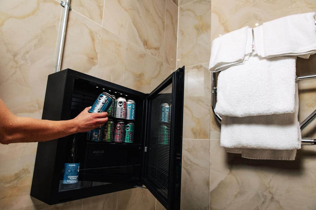 Beer fridge in the shower at Brewdog Kennels, Aberdeen