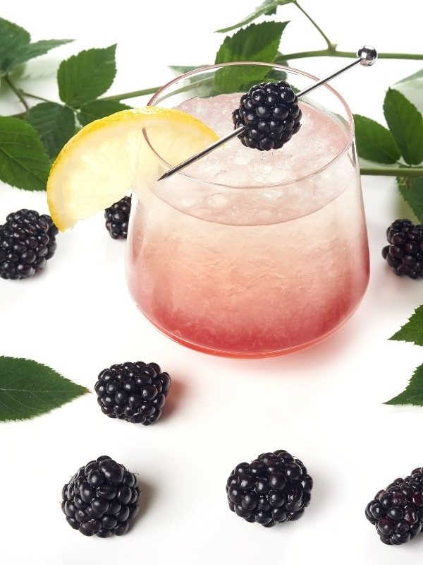 Lemon, blackberries and gin for a Bramble cocktail