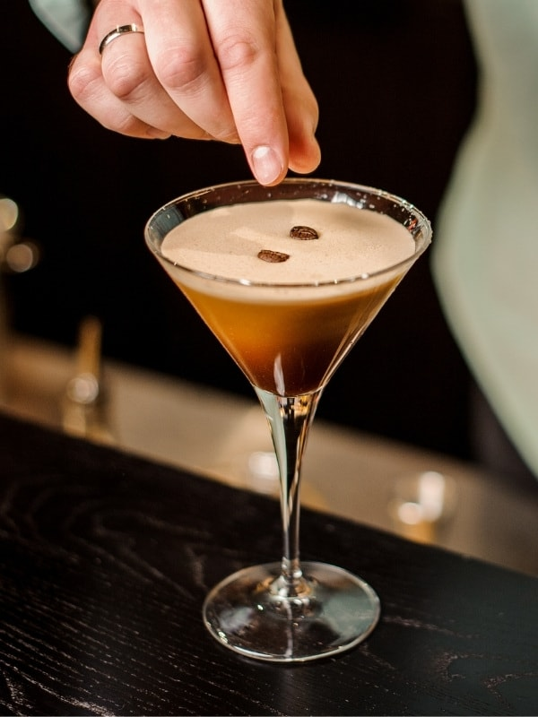 Topping an Espresso Martini with coffee beans