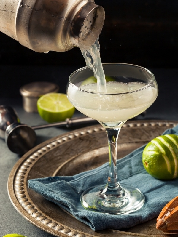 Pouring a Gimlet cocktail